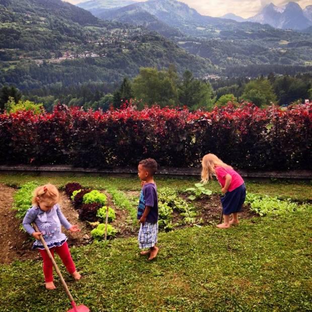 Three of the four mini-cousins (Bee, Luke and Elfie) gardening